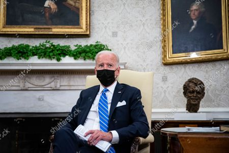 United States President Joe Biden speaks as he meets with Prime Minister Boris Johnson of the United Kingdom in the Oval Office of the White House in Washington, DC, on Tuesday, September 21, 2021.