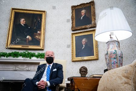 United States President Joe Biden listens as he meets with Prime Minister Boris Johnson of the United Kingdom in the Oval Office of the White House in Washington, DC, on Tuesday, September 21, 2021.