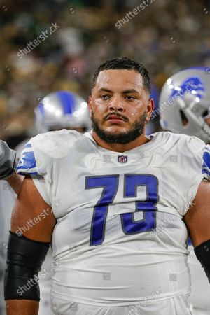Detroit Lions offensive guard Jonah Jackson (73) walks on the sidelines during the first half of an NFL football game against the Green Bay Packers, in Green Bay, Wis