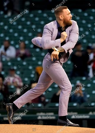Fighter Conor McGregor throws out a ceremonial first pitch before a baseball game between the Chicago Cubs and the Minnesota Twins, in Chicago