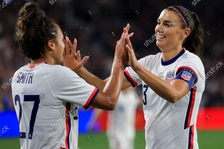United States forward Alex Morgan, right, high-fives Sophia Smith after scoring a goal during the second half of an international friendly soccer match against Paraguay, in Cincinnati. The United States won 8-0