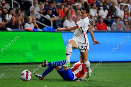 United States forward Sophia Smith (27) battles for the ball against Paraguay defender Deisy Ojeda (14) during the second half of an international friendly soccer match, in Cincinnati. The United States won 8-0