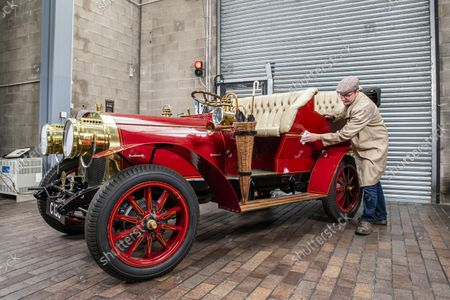National Motor Museum's Ben Wanklyn cleans Mr Toad's car.  Mr Toad's car from Wind in the Willows has gone on display after a painstaking restoration following years of neglect.  The vehicle was made for the 1996 film adaptation of Kenneth Grahame's classic 1908 children's book starring Terry Jones as the obsessive amphibian.  The car, which appears to be from the Edwardian era, was actually built in 1995 at Shepperton Studios for the film.  Following the film's release, it was transported to America, where it spent many years hanging from the ceiling of a Florida restaurant.  It was brought back to Britain last year in a dilapidated state and has been restored at the National Motor Museum workshop in Beaulieu, Hants, where visitors can see it driven around the grounds.