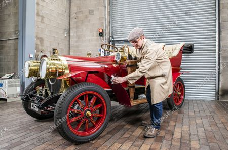 Stock Photo of National Motor Museum's Ben Wanklyn cleans Mr Toad's car.  Mr Toad's car from Wind in the Willows has gone on display after a painstaking restoration following years of neglect.  The vehicle was made for the 1996 film adaptation of Kenneth Grahame's classic 1908 children's book starring Terry Jones as the obsessive amphibian.  The car, which appears to be from the Edwardian era, was actually built in 1995 at Shepperton Studios for the film.  Following the film's release, it was transported to America, where it spent many years hanging from the ceiling of a Florida restaurant.  It was brought back to Britain last year in a dilapidated state and has been restored at the National Motor Museum workshop in Beaulieu, Hants, where visitors can see it driven around the grounds.