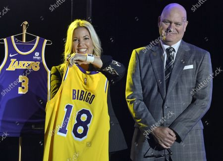 Stock Image of Los Angeles Lakers CEO Jeanie Buss holds a new Lakers jersey next to Tim Harris, Lakers President of Business Operations during the team's kick-off event to announce a new global marketing partnership with Bibigo, a popular South Korean food company at the UCLA Health Training Center in El Segundo, California on Monday, September 20, 2021. The Lakers' $100 million partnership with Bibigo is now the largest jersey patch deal in the NBA. It's also the league's first jersey patch deal with a company outside of the United States and LA's first international partnership in franchise history.