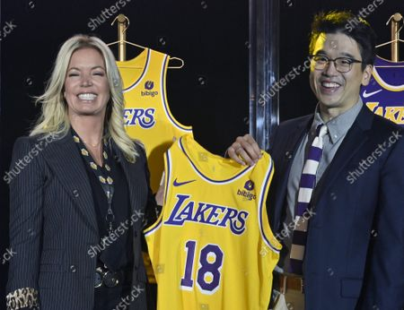 Los Angeles Lakers CEO Jeanie Buss holds a new Lakers jersey with Bibigo Head of Global Business Planning Sun-Ho Lee during the team's kick-off event to announce a new global marketing partnership with Bibigo, a popular South Korean food company at the UCLA Health Training Center in El Segundo, California on Monday, September 20, 2021. The Lakers' $100 million partnership with Bibigo is now the largest jersey patch deal in the NBA. It's also the league's first jersey patch deal with a company outside of the United States and LA's first international partnership in franchise history.