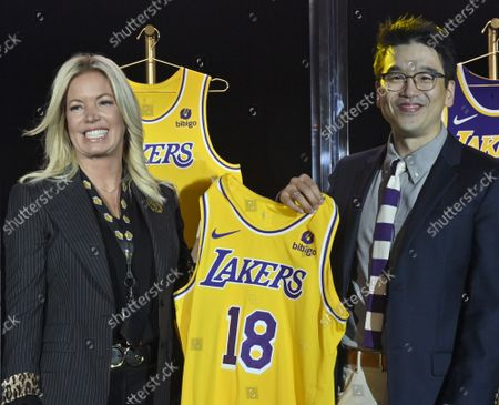 Stock Photo of Los Angeles Lakers CEO Jeanie Buss holds a new Lakers jersey with Bibigo Head of Global Business Planning Sun-Ho Lee during the team's kick-off event to announce a new global marketing partnership with Bibigo, a popular South Korean food company at the UCLA Health Training Center in El Segundo, California on Monday, September 20, 2021. The Lakers' $100 million partnership with Bibigo is now the largest jersey patch deal in the NBA. It's also the league's first jersey patch deal with a company outside of the United States and LA's first international partnership in franchise history.