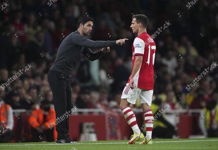 Arsenal manager Mikel Arteta talks to Cedric Soares