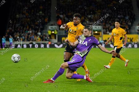 Adama Traore of Wolverhampton Wanderers is challengedby Ben Davies of Tottenham Hotspur.