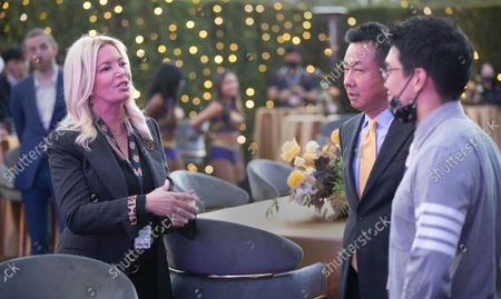 Sun-Ho Lee, Bibigo Head of Global Business Planning, right, Wookho Kyeong, second from right, CMO of CJ CheilJedang, and Jeanie Buss, CEO / Governor / Co-owner of the Los Angeles Lakers, attend the Lakers host a 2021-2022 season kick-off event to unveil and announce a new global marketing partnership with Bibigo, which will appear on the Lakers' jersey at the UCLA Health Training Center in El Segundo on Monday, Sept. 20, 2021. (Allen J. Schaben / Los Angeles Times)