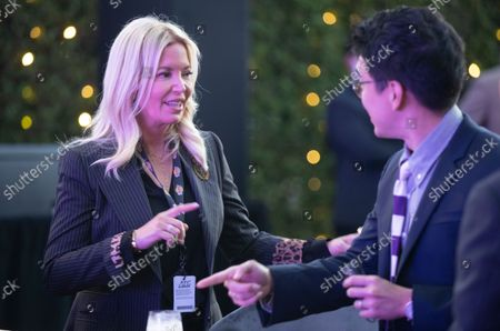 Sun-Ho Lee, right, Bibigo Head of Global Business Planning, and Jeanie Buss, CEO / Governor / Co-owner of the Los Angeles Lakers, attend the Lakers host a 2021-2022 season kick-off event to unveil and announce a new global marketing partnership with Bibigo, which will appear on the Lakers' jersey at the UCLA Health Training Center in El Segundo on Monday, Sept. 20, 2021. (Allen J. Schaben / Los Angeles Times)