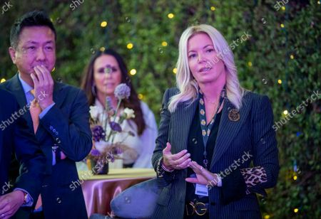 Wookho Kyeong, left, CMO of CJ CheilJedang, and Jeanie Buss, CEO / Governor / Co-owner of the Los Angeles Lakers, attend the Lakers host a 2021-2022 season kick-off event to unveil and announce a new global marketing partnership with Bibigo, which will appear on the Lakers' jersey at the UCLA Health Training Center in El Segundo on Monday, Sept. 20, 2021. (Allen J. Schaben / Los Angeles Times)