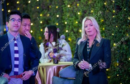 Sun-Ho Lee, Bibigo Head of Global Business Planning, left, Wookho Kyeong, second from left, CMO of CJ CheilJedang, and Jeanie Buss, CEO / Governor / Co-owner of the Los Angeles Lakers, attend the Lakers host a 2021-2022 season kick-off event to unveil and announce a new global marketing partnership with Bibigo, which will appear on the Lakers' jersey at the UCLA Health Training Center in El Segundo on Monday, Sept. 20, 2021. (Allen J. Schaben / Los Angeles Times)