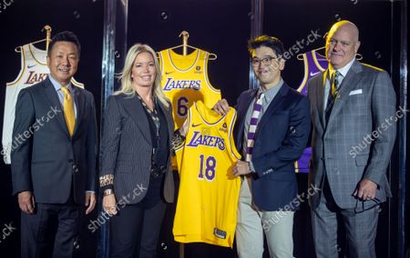 From left: Wookho Kyeong, CMO of CJ CheilJedang, Jeanie Buss, CEO / Governor / Co-owner of the Los Angeles Lakers, Sun-Ho Lee, Bibigo Head of Global Business Planning, Tim Harris, Lakers President of Business Operations, as the Lakers host a 2021-2022 season kick-off event to unveil and announce a new global marketing partnership with Bibigo, which will appear on the Lakers' jersey at the UCLA Health Training Center in El Segundo on Monday, Sept. 20, 2021. (Allen J. Schaben / Los Angeles Times)