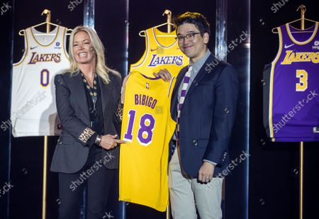 Jeanie Buss, CEO / Governor / Co-owner of the Los Angeles Lakers, left, and Sun-Ho Lee, Bibigo Head of Global Business Planning, hold a jersey featuring the Bibigo logo, as the Lakers host a 2021-2022 season kick-off event to unveil and announce a new global marketing partnership with Bibigo, which will appear on the Lakers' jersey at the UCLA Health Training Center in El Segundo on Monday, Sept. 20, 2021. (Allen J. Schaben / Los Angeles Times)