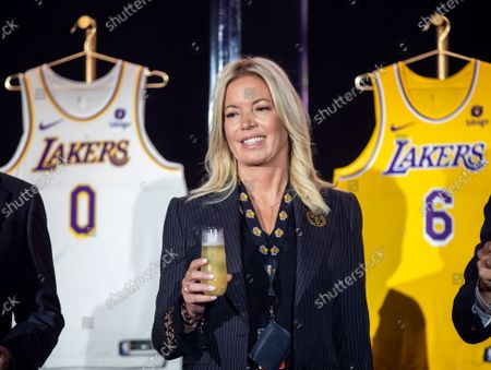 Jeanie Buss, CEO / Governor / Co-owner of the Los Angeles Lakers, holds a new Lakers jersey as the Lakers host a 2021-2022 season kick-off event to unveil and announce a new global marketing partnership with Bibigo, which will appear on the Lakers' jersey at the UCLA Health Training Center in El Segundo on Monday, Sept. 20, 2021. (Allen J. Schaben / Los Angeles Times)