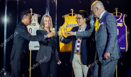 From left: Wookho Kyeong, CMO of CJ CheilJedang, Jeanie Buss, CEO / Governor / Co-owner of the Los Angeles Lakers, Sun-Ho Lee, Bibigo Head of Global Business Planning, Tim Harris, Lakers President of Business Operations, toast as the Lakers host a 2021-2022 season kick-off event to unveil and announce a new global marketing partnership with Bibigo, which will appear on the Lakers' jersey at the UCLA Health Training Center in El Segundo on Monday, Sept. 20, 2021. (Allen J. Schaben / Los Angeles Times)