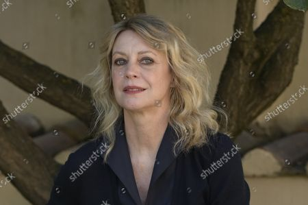 Stock Photo of Margherita Buy attends the photocall of the film 'Tre piani' ('Three Floors') at the garden of the Hotel Donna Camilla Savelli