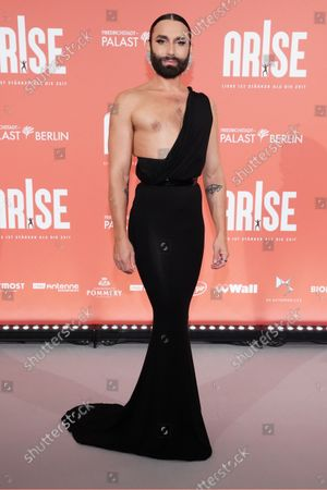 Austrian singer Thomas Neuwirth, known as the artist Conchita Wurst, attends the premiere of the 'ARISE Grand Show' at the Friedrichstadt-Palast theater in Berlin, Germany, 22 September 2021.