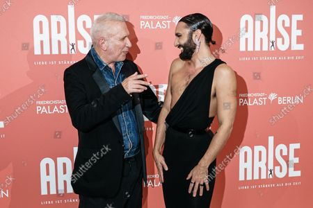 Jean-Paul Gaultier (L) and Austrian singer Thomas Neuwirth, known as the artist Conchita Wurst, attend the premiere of the 'ARISE Grand Show' at the Friedrichstadt-Palast theater in Berlin, Germany, 22 September 2021.