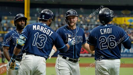 Tampa Bay Rays' Austin Meadows celebrates his three-run home run with Randy Arozarena (56), Manuel Margot (13) and Ji-Man Choi (26) off Toronto Blue Jays relief pitcher Ross Stripling during the third inning of a baseball game, in St. Petersburg, Fla