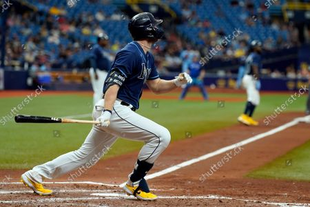 Stock Image of Tampa Bay Rays' Austin Meadows watches his three-run home run off Toronto Blue Jays pitcher Ross Stripling during the third inning of a baseball game, in St. Petersburg, Fla