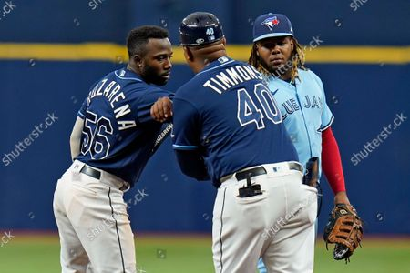 Stock Picture of Tampa Bay Rays' Randy Arozarena (56) celebrates with first base coach Ozzie Timmons (40) after his double off Toronto Blue Jays pitcher Ross Stripling during the third inning of a baseball game, in St. Petersburg, Fla. Looking on is Blue Jays' Vladimir Guerrero Jr