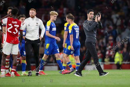 Arsenal manager Mikel Arteta applauding during the EFL Cup match between Arsenal and AFC Wimbledon at the Emirates Stadium, London