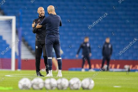 Stock Picture of Luke Williams, Assistant Head Coach of Swansea City greeting Brighton's Bruno Salter ahead of the EFL Cup match between Brighton and Hove Albion and Swansea City at the American Express Community Stadium, Brighton and Hove