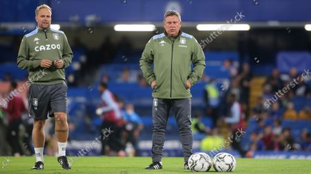 Stock Image of Aston Villa's First Team Coach, Aaron Danks and Assistant Head Coach, Craig Shakespeare during Chelsea vs Aston Villa, Carabao Cup Football at Stamford Bridge on 22nd September 2021