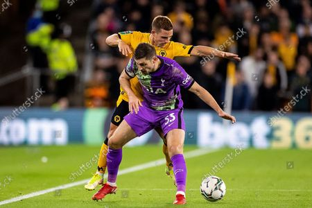 Daniel Podence of Wolverhampton Wanderers battles for possession with Ben Davies of Tottenham Hotspur during the EFL Cup match between Wolverhampton Wanderers and Tottenham Hotspur at Molineux, Wolverhampton