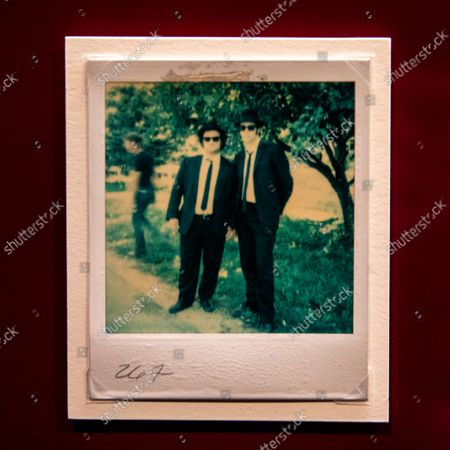 """An original photo showing John Belushi and Dan Aykroyd, in costume, from the 1980 John Landis-directed film, """"The Blues Brothers,"""" as part of the """"Identity"""" gallery with forty costumes and many costume design sketches, as part of the Stories of Cinema exhibit, a multi-room experience entitled """"Inventing Worlds & Characters,"""" photographed at the Academy Museum of Motion Pictures, in Los Angeles, CA, Tuesday, Sept. 21, 2021. (Jay L. Clendenin / Los Angeles Times)"""
