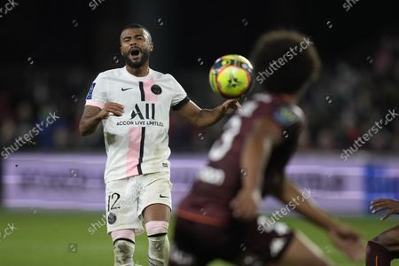 PSG's Rafinha grimaces after missing a chance during the French League One soccer match between FC Metz and Paris Saint-Germain at Saint Symphorien stadium, in Metz, eastern France
