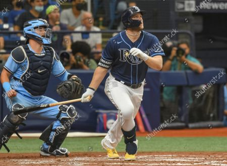 Stock Photo of Toronto Blue Jays catcher Reese McGuire (L) looks on as Tampa Bay Rays' Austin Meadows (R) hits a three-run home run off Toronto reliever Ross Stripling during the third inning at Tropicana Field in St. Petersburg, Florida on Wednesday, September 22, 2021.