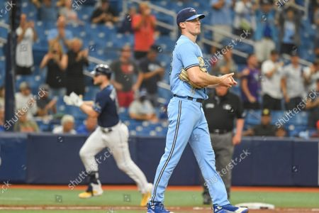 Tampa Bay Rays Austin Meadows (L) circles the bases after hitting a three-run home run off Toronto Blue Jays reliever Ross Stripling (R) during the third inning at Tropicana Field in St. Petersburg, Florida on Wednesday, September 22, 2021.