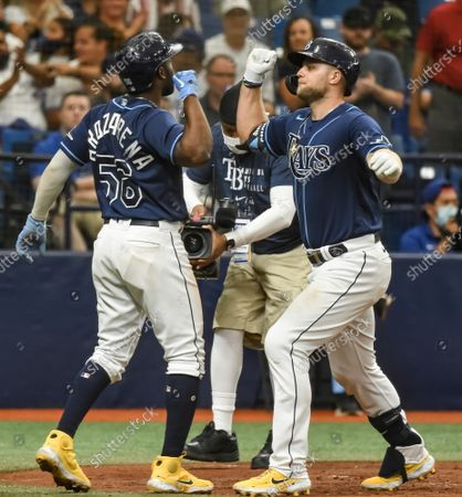 Tampa Bay Rays' Randy Arozarena (56) and Austin Meadows celebrate after Meadows hit a three-run home run off Toronto Blue Jays reliever Ross Stripling during the third inning at Tropicana Field in St. Petersburg, Florida on Wednesday, September 22, 2021.