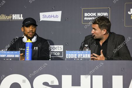 Anthony Joshua with Eddie Hearn during his pre-fight press conference