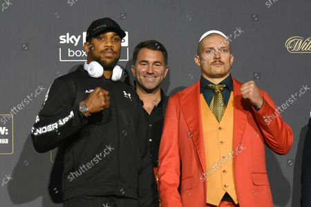 Anthony Joshua (L), Eddie Hearn and Oleksandr Usyk during a Press Conference at Tottenham Hotspur Stadium on 23rd September 2021