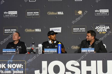 Robert McCracken (L), Anthony Joshua and Eddie Hearn during a Press Conference at Tottenham Hotspur Stadium on 23rd September 2021