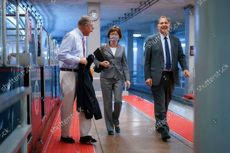 """From left, Sen. Richard Burr, R-N.C., Sen. Susan Collins, R-Maine, and Sen. John Boozman, R-Ark., return to the Senate chamber for a vote after attending a bipartisan barbecue luncheon, at the Capitol in Washington, . Senate Majority Leader Chuck Schumer and House Speaker Nancy Pelosi say they and the White House have agreed to a """"framework"""" to pay for their emerging $3.5 trillion social and environment bill"""