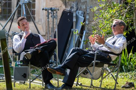 actor Tom Brittney (vicar) and Robson Green checking their lines during the filming of the new series of the ITV drama Grantchester this week (Sept 16) in the village of Grantchester near Cambridge.