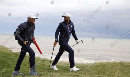 US team member Dustin Johnson (R) and vice-captain Davis Love III on the fourth hole during a practice round for the pandemic-delayed 2020 Ryder Cup golf tournament at the Whistling Straits golf course in Kohler, Wisconsin, USA, 23 September 2021. Competition for the 43rd Ryder Cup between the US and Europe begins 24 September 2021.