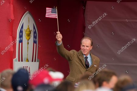 Team USA captain Steve Stricker waves a flag during the opening ceremony for the Ryder Cup at the Whistling Straits Golf Course, in Sheboygan, Wis