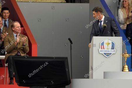 Team Europe captain Padraig Harrington looks at Team USA captain Steve Stricker as he speaks during the opening ceremony for the Ryder Cup at the Whistling Straits Golf Course, in Sheboygan, Wis