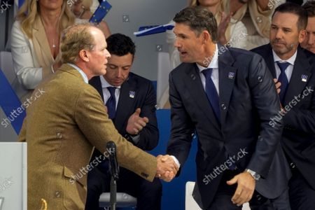 Team USA captain Steve Stricker shakes hands with Team Europe captain Padraig Harrington during the opening ceremony for the Ryder Cup at the Whistling Straits Golf Course, in Sheboygan, Wis