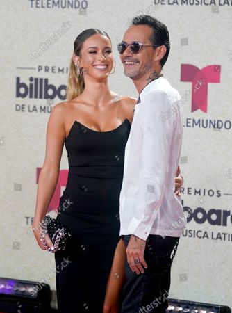 Marc Anthony, right, arrives at the Billboard Latin Music Awards, at the Watsco Center in Coral Gables, Fla