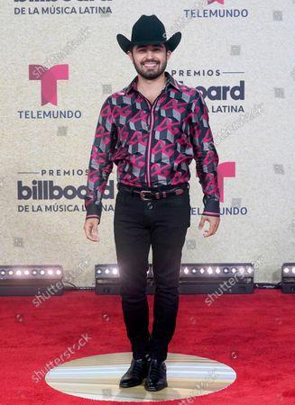 Joss Favela arrives at the Billboard Latin Music Awards, at the Watsco Center in Coral Gables, Fla