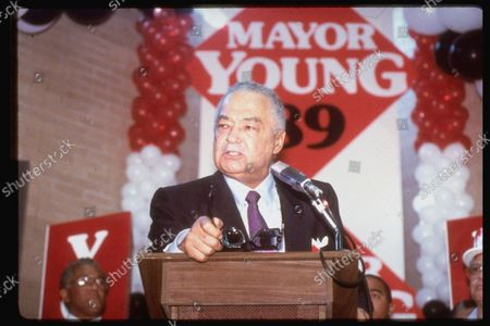 Stock Picture of Detroit Mayor Coleman Young campaigning w. his name on wall behind & balloons.