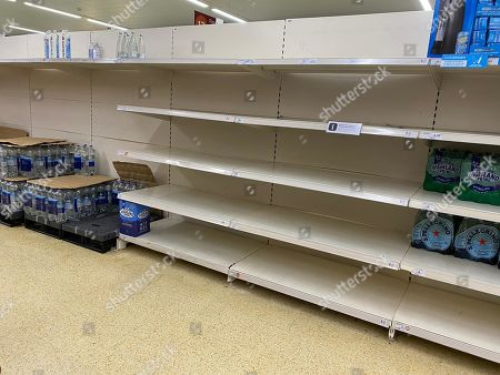 Empty supermarket shelves are seen in a Sainsbury's superstore in London Conley