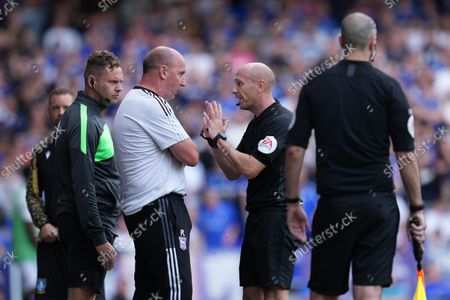 Ipswich Town Manager Paul Cook is warned by Referee Nigel Lugg